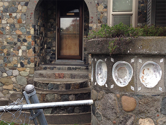 Detail of Stone house at 2203 S. 118th St. Note the full abalone shells embedded into the concrete!
