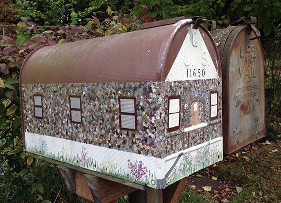 Even the mailbox of the Hamel house on Roseberg Ave. S. is decorated to mimic the house.